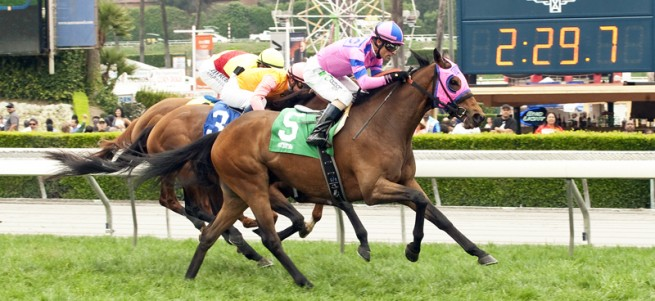 Ashleyluvssugar and jockey Gary Stevens, outside, overpower Ganesh (Flavien Prat), second from left, and Going Somewhere (Mike Smith), inside, to win the Grade II, $200,000 Charles Whittingham Stakes, Sunday, May 24, 2015 at Santa Anita Park, Arcadia CA. © BENOIT PHOTO