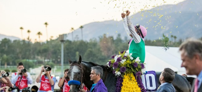ARCADIA, CA - NOVEMBER 05: Mike Smith, aboard Arrogate #10, celebrates after winning the Breeders' Cup Classic during day two of the 2016 Breeders' Cup World Championships at Santa Anita Park on November 5, 2016 in Arcadia, California. (Photo by Michael McInally/Eclipse Sportswire/Breeders Cup)