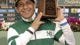Triple Crown champion jockey Victor Espinoza, a 43-year-old native of Mexico City, having been selected by a vote of jockeys nationwide as the winner of Santa AnitaÕs highly coveted 2016 George Woolf Memorial Jockey Award, accepted that trophy in a winnerÕs circle ceremony today, March 13, 2016 at Santa Anita Park, Arcadia, CA.Benoit Photo